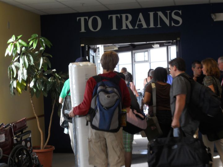 Lincoln Middle School students board the train with their props
