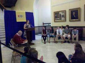 Rep. Emily Cain addresses students in the Hall of Flags